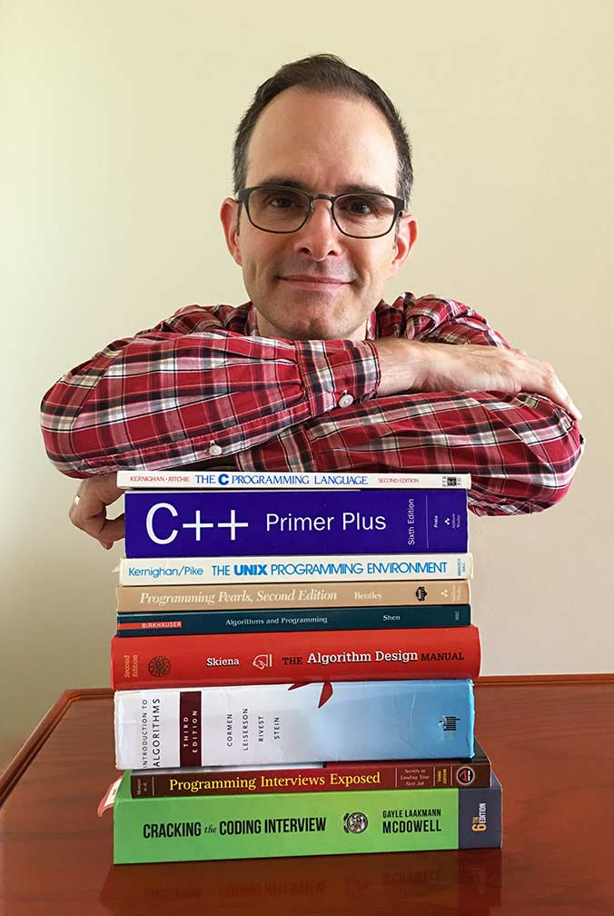 John Washam and his stack of computer science books, preparing for the software engineer interview